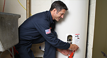 Mike has finished repairing this malfunctioning water heater
